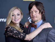Actors Emily Kinney (L) and Norman Reedus arrive at the premiere of AMC's 'The Walking Dead' 4th season at Universal CityWalk on October 3, 2013 in Universal City, California.