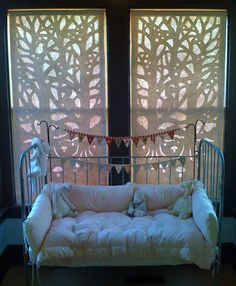 These are really cool - paper cut outs that you can hang in your window. The blog explains how they were made and also sells a template. From Hutch Studio