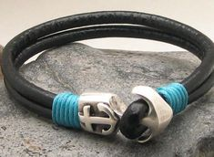 Handcrafted black leather bracelet with a nautical grade steel omega lock clasp. Shipped in a gift-worthy natural burlap pouch. Custom designed and sized. Bracelet Clasps, Strand Bracelet, Cuff Bracelets, Anchor Bracelets, Black Leather Bracelet, Leather Jewelry, Leather Bracelets, Nautical Bracelet, Turquoise Accents