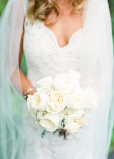 White ranunculus bouquet: http://www.stylemepretty.com/new-york-weddings/saratoga-springs/2015/10/12/elegant-saratoga-springs-summer-wedding/   Photography: Lindsay Madden - http://lindsaymaddenphotography.com/
