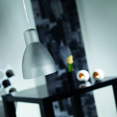 Simple yet stylish aluminium pendant.  http://www.worldstores.co.uk/p/Nordlux_Cyclone_Aluminium_Metal_Pendant.htm