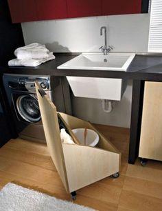This DIY pallet wood storage bin with wheels provides movable storage under the sink. http://hative.com/creative-under-sink-storage-ideas/