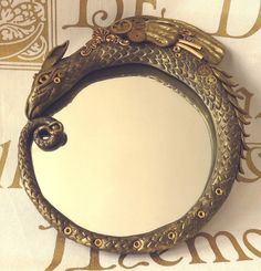 COGSWORTH Steampunk Dragon Mirror polymer clay sculpt by Esther Remmington. £35.00, via Etsy.