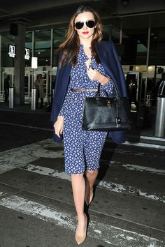 Miranda Kerr A ladylike dress, matching coat, and bold red lip will ensure you're ready to go anywhere as soon as you land.