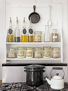 Utiulize space over appliances or sinks in a kitchen with a shelving unit   belle maison