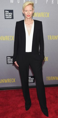 Tilda Swinton brought her sleek eccentric edge to the Trainwreck premiere, suiting up with black tailored separates, complete with a plunging white blouse and black pumps. Tilda Swinton, Haider Ackermann, Celebrity Look, Celebrity Dresses, Star Fashion, Fashion Show, White Tuxedo Wedding, Tuxedo Styles, Podium