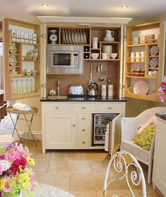 A cupboard, in reality a mini kitchen