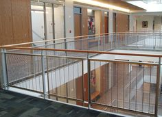 Banker Wire's Versatile Spine wire mesh frames were customized to suit the designer's preference for joining a powder coat finished flat bar to the M13Z-145 stainless steel wire mesh.