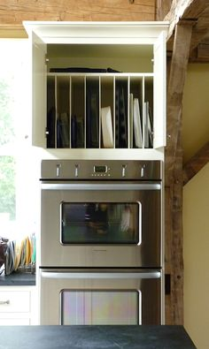 Great vertical storage for cookie sheets, cutting boards, etc. - I love baking and want a nice organization system.... inspiration!!
