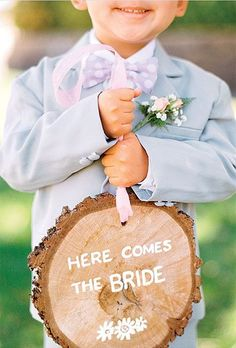 Ring Bearer and signs on tree stump