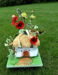 English Country Watering Can.  The watering can cottage is fruit cake.  all the flowers and foliage are cp