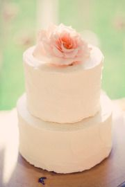 simple wedding cake with single flower as topper. Would also work for the little cakes