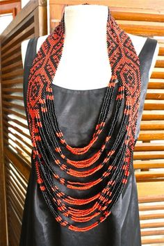 Coral Snake long and layered necklace of seed beads approx. $68.00
