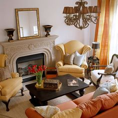 The coffee table, although large and dark, is a space-savvy choice because it is within reach of all of the seating pieces. The dark color grounds the pastels and gives the soft colors needed emphasis. Sofa with two wing back chair arrangement with fireplace...