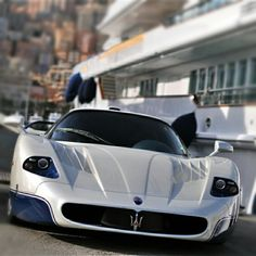 Gorgeous Maserati parked by a super yacht