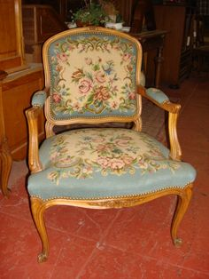 Hand Carved Needle Point Arm Chair   this would be beautiful for my mom cave