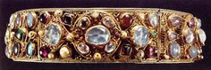 Crown of Empress Kunigunde. This crown belonged to the wife of the Emperor Henry II of Bavaria, the Empress Kunigunde and was crafted sometime in the early 10th c. The coronet is set with large sapphires, amethysts, pearls, carnelians, peridots and topazes.