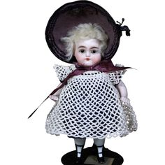 All-Bisque Doll with Glass Eyes by ABG with Two Strap Bootines