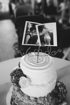 Polaroid pictures are a unique idea for w wedding cake topper. One One Photography.