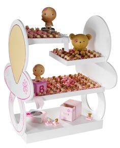 Baby girl stand with decorated chocolate and souvenirs by Patchi