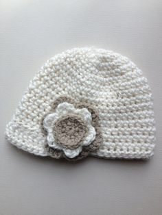 Girls crochet newsboy cap with small peak and flower detail. Off-white cap with fawn and off-white flower. Other colours available. on Etsy, $18.00 AUD