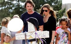 Christian Bale visiting the makeshift memorial in Aurora, CO