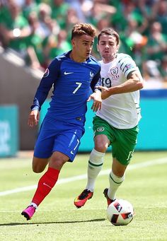#EURO2016 Antoine Griezmann of France vies with Robbie Brady of Ireland during the UEFA Euro 2016 Round of 16 football match between France and Ireland at the...