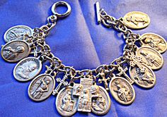 $119 - 7 inch silver tone charm bracelet is loaded with hard to find (rare) Catholic Saints Holy medals featuring the following:  Center cross with Jesus, Virgin Mary   & St. Joseph on one side and  St. Christopher on the other side.  St. Philomena  St. Monica / St. Augustine   Padre Pio  St. Joan of Arc  St. Francis of Assisi  St. Catherine of Assisi  St. Lawrence  St. Stephen  St. Barbara  St. Therese  St. John the Evangelist  Key to Heaven featuring our Lady of Grace  6 cross Charms
