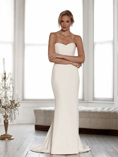 Jessica - This figure-hugging, strapless, fishtail dress is made from luxurious silk crepe with a classic sweetheart neckline and extra button detail down the back. Beautifully contoured and timeless.