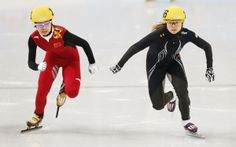Feb 18, 2014; Sochi, RUSSIA; Jessica Smith (USA), right, and Li Jianrou (CHN), left, skate in the short track speed skating ladies' 1000m heats during the Sochi 2014 Olympic Winter Games at Iceberg Skating Palace. Mandatory Credit: Jeff Swinger-USA TODAY Sports
