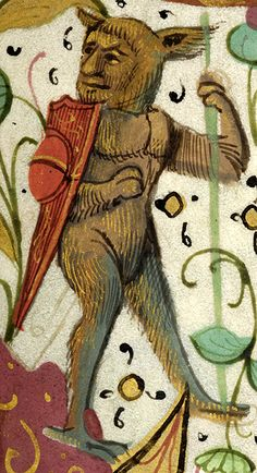 Wild man, wearing shield on right shoulder, grasping stem of daisy with left paw | Breviary | France | ca. 1511 | The Morgan Library & Museum