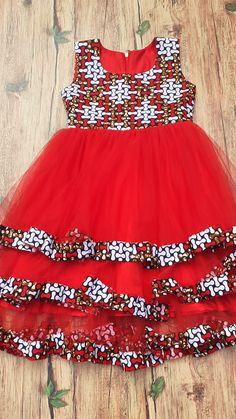 african dress styles An African wax print sleeveless girl's tiered tulle dress. Outfit fully lined with satin fabric and fits an 8 year old with the length almost to the ankle. Baby African Clothes, African Dresses For Kids, Latest African Fashion Dresses, African Dresses For Women, African Print Dresses, African Kids, Ankara Fashion, Tribal Fashion, African Attire