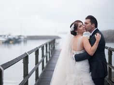 Bride wears a silk beaded lace bodice and soft tulle skirt by personalisedweddingscouture.com.au at Earlwood #weddingdress #weddings #bridalgown #brides
