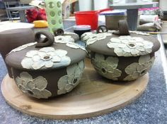 Lidded bowls with poppies in progress. By Sally Anne Stahl - www.clayshapergallery.com