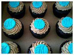 Vegan chocolate cupcakes w/vegan peanut butter buttercream with teal monogram for a beautiful wedding.