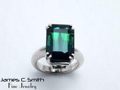 Blue green tourmaline set in 14k white gold ring.