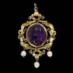 This pendant has several alterations.The pearl drops are replacements and the enamelled plate at the back was removed and reinstated upside down at some stage. The cameo is likely to have been made in the Renaissance and the setting around 1550 to 1560, perhaps in England. The jewel belonged to the Gatacre family of Shropshire. It was known as the 'Fair Maid of Gatacre' after Mary (born 1509), daughter of Sir Robert Gatacre.