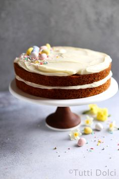 This is classic carrot cake at its finest: fluffy and tender carrot cake, perfectly spiced, topped with plush piles of cream cheese frosting.