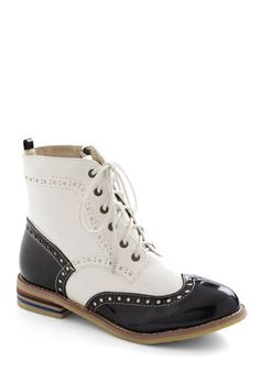 WANT!!!!!! (of course they're out of my size, grrrrr) Wing-tipped for Glory Bootie, #ModCloth