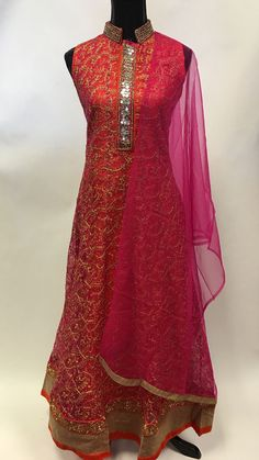 This designer suit is a combination of a silk n net embroidered kurta along with churidar pants and dupatta. The kurta has an ornate, broad yoke with fine beaded embroidery and mirror work.The inner l