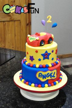 The wiggles 2 tiered birthday cake. Brightly colored With the Wiggles car for topper. Wiggles Cake, Wiggles Party, Wiggles Birthday, The Wiggles, Toddler Birthday Cakes, 3rd Birthday Cakes, Birthday Themes For Boys, Baby Boy First Birthday, Birthday Ideas