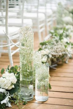 White and green floral decor with baby's breath along the aisle // Francois and Karis both hail from the fashion industry, so you can imagine the level of attention they paid to the design of their wedding at Aleenta Phuket Resort & Spa on the pristine Natai Beach. At the top of the couple's wish list was something unconventional and nature-inspired. The Wedding Bliss Thailand's palette of calming sea and froth colours, combined with unique flowers, were a perfect match for the couple's...