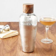 Mix it up for your next get-together with this Mid-Century Cocktail Shaker. Vintage-inspired, its stainless steel shaker and sheesham wood top make it a great gift year round.