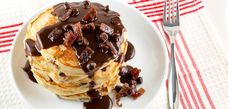 Chocolate Chip and Candied Bacon Pancakes with Nutella Maple Syrup. This recipe and lots more at this site if you love Nutella!