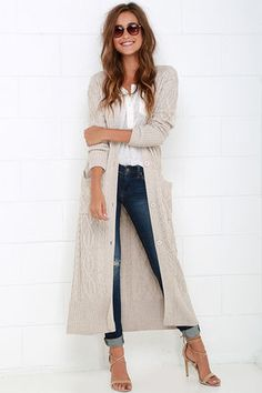 At Great Length Beige Long Cardigan Sweater. Perfectly soft cable knit has a thick and cozy construction that forms a ribbed V-neckline secured with a midi-length placket of large beige buttons. Long fitted sleeves are finished with ribbed cuffs, while two front patch pockets offer the perfect place to keep your hands warm. Unlined. 41% Polyester, 35% Viscose, 20% Nylon, 4% Cashmere. Hand Wash Cold. Imported.