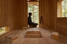 The interior of this cabin is designed to be occupied in different ways, by arranging and storing wooden blocks in unique arrangements.