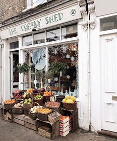 New owners of this quirky fresh produce/grocery/vintage kitchenware shop say they restored it to look like gramps' shop in London......
