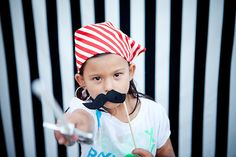 Pirate bday: fake mustache and black & white photo backdrop area for pictures - such a cute idea!