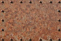 Heavily Rusted Metal Plate with Rivets by Richard Hausdorf