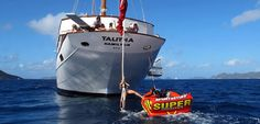 Classic Yacht Talitha with towable toys and charter guests
